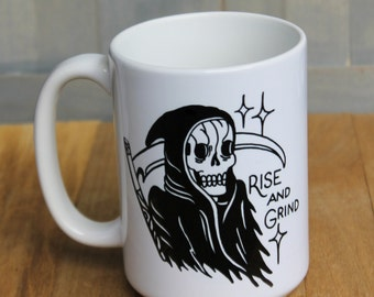 """Reaper """"Rise and Grind"""" coffee mug! 15 ounce ceramic coffee cup with reaper tattoo style design!"""