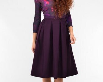Dark purple knee length skirt with pockets and pleats