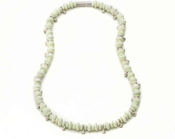 Necklace, pale green chrysoprases, sterlingsilver.