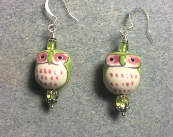 Green and pink ceramic owl bead earrings adorned with green Czech glass beads.