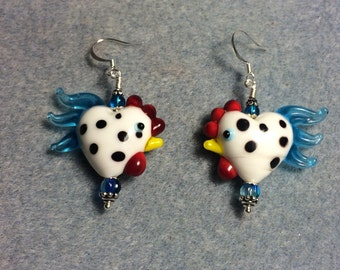 White with black spots and turquoise tails heart shaped lampwork rooster bead earrings adorned with turquoise Czech glass beads.