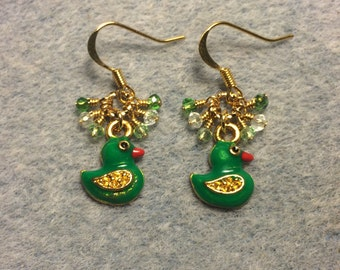 Green enamel duck charm earrings adorned with tiny dangling green Chinese crystal beads.