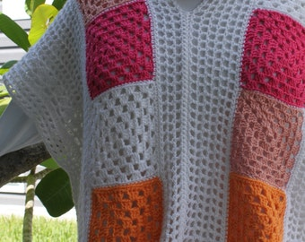 Women's XX-large poncho, sweater.  100% acrylic white, with pink and orange granny square accents.