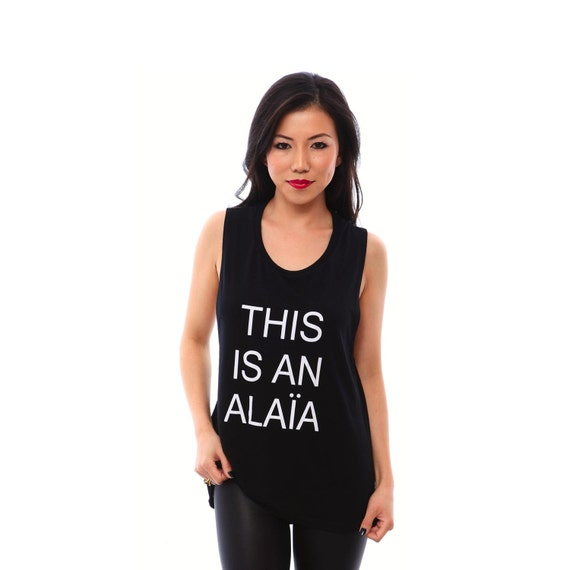THIS is AN ALAIA - Women Tank tops. Christmas Gifts, Funny Shirts, Muscle Tanks, Workout Shirts, Workout Tanks, Gifts for Best Friend