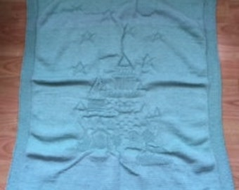 Handmade hand-knitted soft blue green turquoise colour kids baby blanket cover throw with embossed fairy castle motif pattern