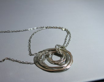Hammered  pendant on a long chain necklace