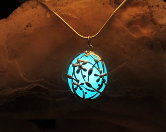Lovely flower pendant with sterling silver chain glow in the dark