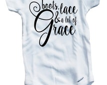Boots, lace, & a lot of grace on The Laughing Giraffe 7.5 oz Baby Outfit One Piece