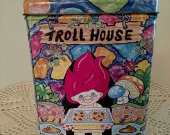 Troll house Tin vintage 1980's. Nice clean vintage condition with vivid colors. Edge rust and a small discoloration inside.