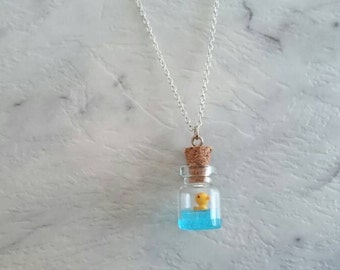 Rubber duck in a miniature charm glass bottle silver chain necklace.