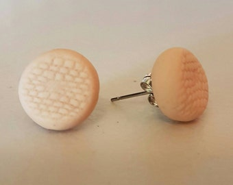 Cute polymer clay stud earrings with lace imprint.