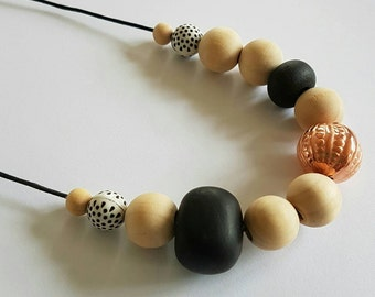 Wooden, clay and copper beaded necklace.
