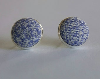 Purple and white floral fabric button stud earrings.