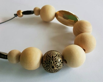 SALE Natural wooden and black and gold beaded necklace.