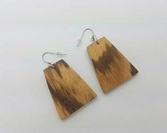 Handmade earrings. Made from zebra wood.
