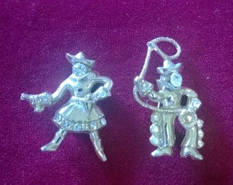 Vintage cowboy and cowgirl gold tone and rhinestone brooches