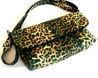 Small leopard print messenger bag.  Adjustible strap for crossbody.  Handmade by RiverPurseWorks