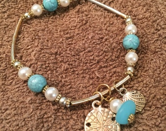 Sea Glass and Charm stretch Bracelet, with white, Turquoise, gold, and silver beads, Beach theme jewelry
