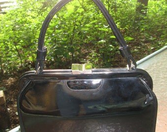 Vintage made in USA black patent leather Kelly Madman top handle purse. ATLA USA stamp.Excellent vintage condition.