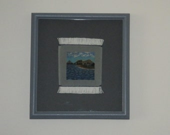 Pictorial, handmade, hand knotted miniature rug with a handmade Frame