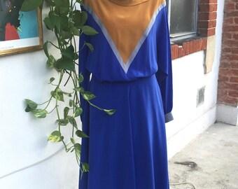 Vintage fantastische jurk. Jaren tachtig vorm. Bluette en mosterd kleur.