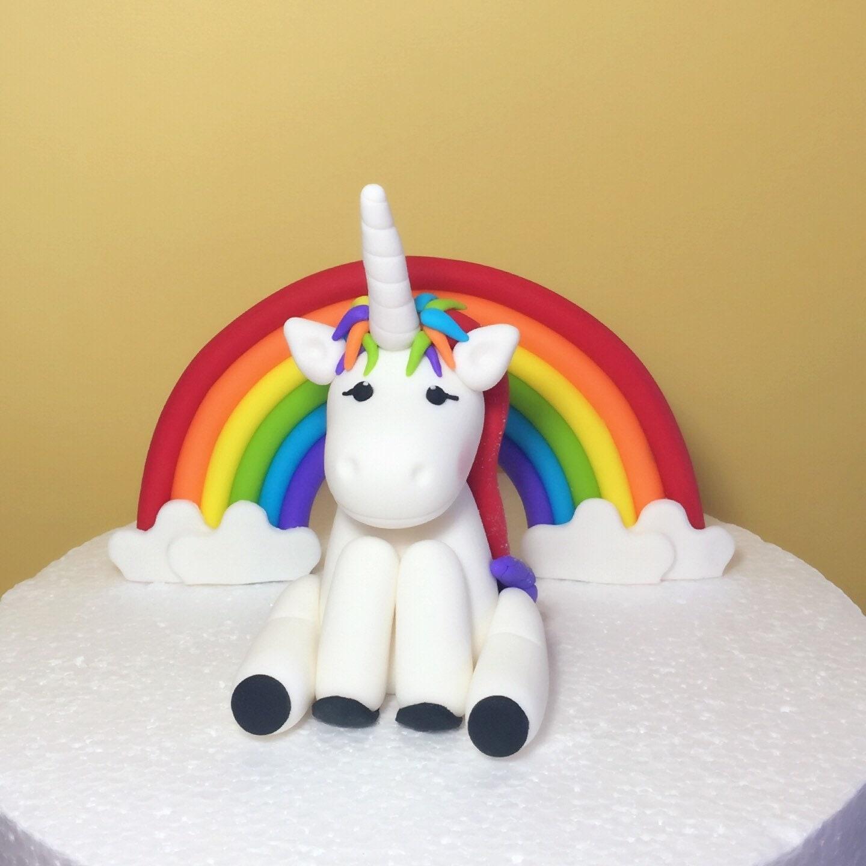 Fondant unicorn cake topper with fondant rainbow Fondant