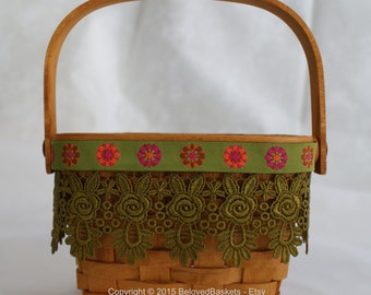 Small Longaberger basket with Venice lace and brocade ribbon