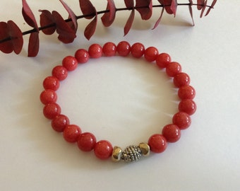 """Yoga Jade """" action stone """" red mountain jade wrist mala. Bead promotes wisdom ,strength , passion and the ability to take action on maters ."""