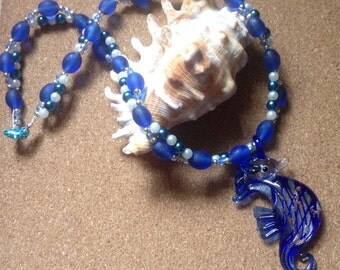 Stunning deep sea blue seahorse necklace