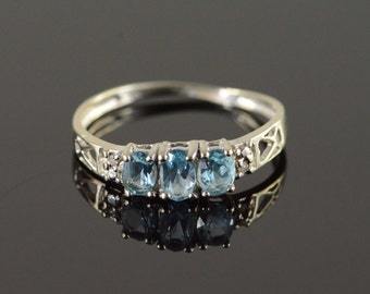 10K 0.61 CTW Blue Topaz 3 Stone Diamond Accented Ring Size 7 White Gold