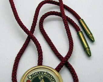 Vintage Calgary Stampede Bolo Tie 1975 TM Red Bullet Style Tips Red Cord Alberta Cowboy Lasso  Canada Easter Gift