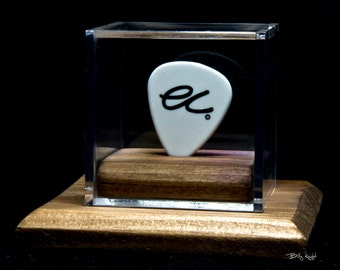 ERIC CLAPTON guitar pick in a display case