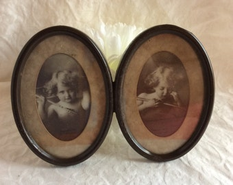 Antique print Cupid awake, cupid asleep. Original double frame made from tin in 1897 by Taber Prong Art Company.