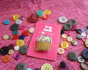 Free motion machine embroidered and appliqué cupcake shaped brooch