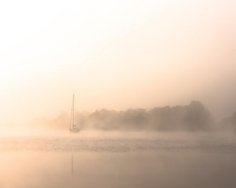 Sailing boat in the morning fog in Ireland