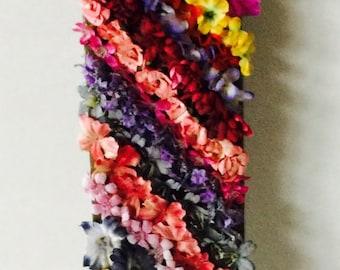 Rainbow flowers on picket