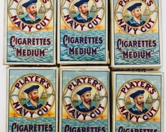 Six iconic Player's Navy Cut Cigarette Packets. Vintage condition with lovely Patina. Be the 'Hero' you know you can be at Goodwood Revival.