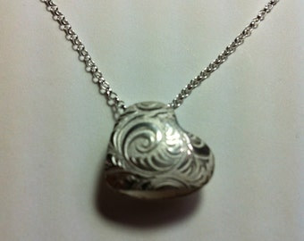 Double sided silver heart pendant