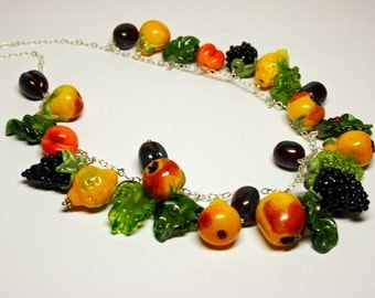 Handmade summer lampwork necklace with murano glass fruit assembled on silver 925 chain