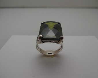 """Faceted Peridot 11/16"""" x 1/2"""" mounted in  stamped Sterling Silver size 7.5"""