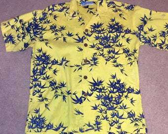 Vintage short-sleeve Hawaiian shirt by Ocean Pacific in bright yellow and blue, Sz S