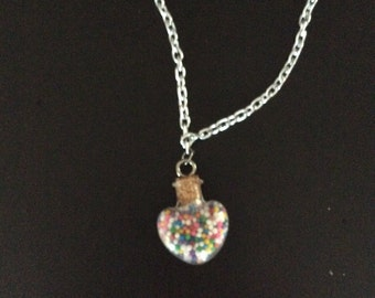 Necklace with heart and real candy sprinkles