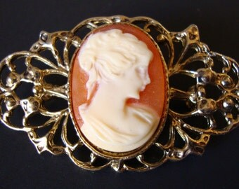 Vintage Gold Tone Ornate and Molded Cameo Victorian Revival Brooch.