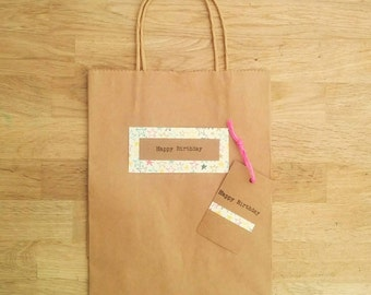 Kraft brown paper gift bag with matching gift tag