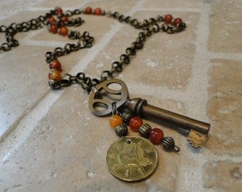 Vintage Skeleton Key, Wolf Coin, and Carnelian Beads on Brass Chain