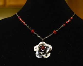 flower pendant and ruby beads