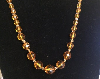 Faceted Amber coloured glass beads***