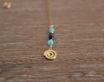 Turquoise, agate and crystal beads with a spiral pendant necklace