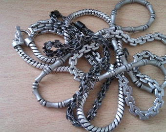 4 silver coloured chains
