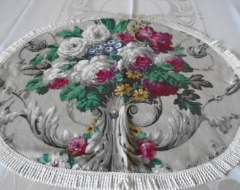 Floral Table doily with tassle trim edging.